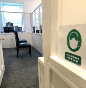 office with face mask sign